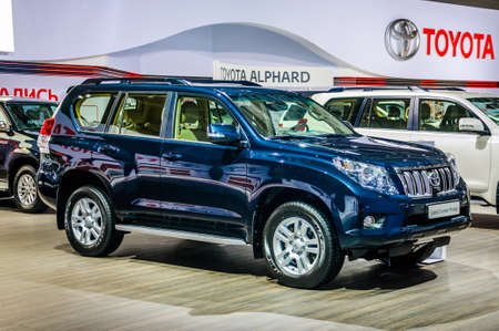 trade off: MOSCOW, RUSSIA - AUG 2012: TOYOTA LAND CRUISER PRADO J150 presented as world premiere at the 16th MIAS Moscow International Automobile Salon on August 30, 2012 in Moscow, Russia Editorial