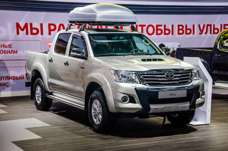 MOSCOW, RUSSIA - AUG 2012: NISSAN HILUX DOUBLE CAB 6TH GENERATION presented as world premiere at the 16th MIAS Moscow International Automobile Salon on August 30, 2012 in Moscow, Russia