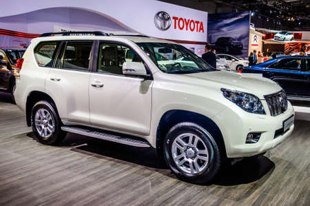 off road racing: MOSCOW, RUSSIA - AUG 2012: TOYOTA LAND CRUISER PRADO J150 presented as world premiere at the 16th MIAS Moscow International Automobile Salon on August 30, 2012 in Moscow, Russia Editorial