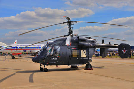 hoodlum: MOSCOW, RUSSIA - AUG 2015: utility helicopter Ka-226 Hoodlum presented at the 12th MAKS-2015 (International Aviation and Space Show) on August 28, 2015 in Moscow, Russia