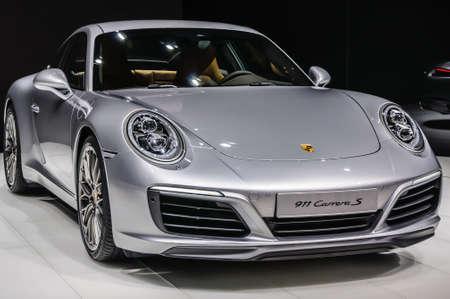 FRANKFURT - SEPT 2015: Porsche 911 991 Carrera S coupe presented at IAA International Motor Show on September 20, 2015 in Frankfurt, Germany Редакционное