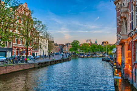 amstel: Amstel river with beautiful houses in Amsterdam, Holland, Netherlands, HDR