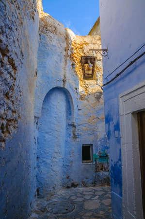 medina: Oriental narrow street with blue houses in Medina, Hammamet Tunisia.