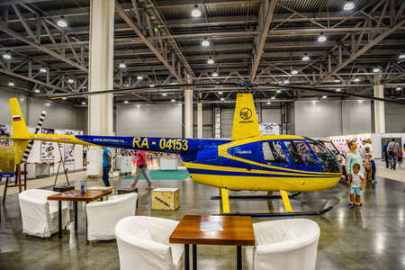 autoshow: MOSCOW - AUG 2016: Robinson R44 helicopter presented at MIAS Moscow International Automobile Salon on August 20, 2016 in Moscow, Russia.