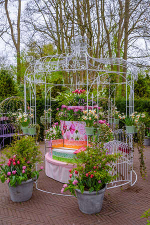 Cage with flowers in Keukenhof park, Lisse, Holland, Netherlands