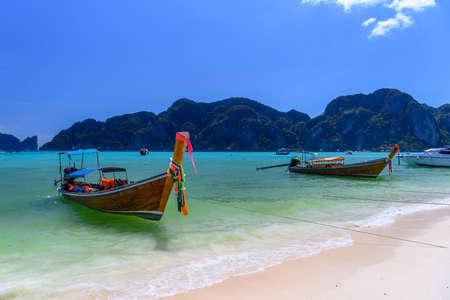 Long tail boats on tropical beach, Phi Phi Don, Andaman sea, Krabi, Thailand Stock Photo