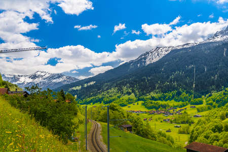 Railway in Alps mountains, Klosters-Serneus, Davos,  Graubuenden Switzerland 免版税图像