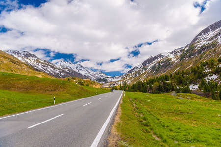 Road amoung snowy Alps mountains, Fluelapass, Davos,  Graubuenden Switzerland
