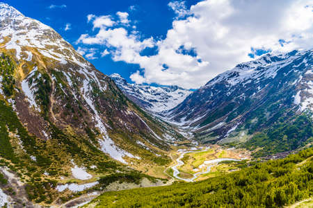 Mountain river in Alps covered with snow, Fluelapass, Zernez, Graubuenden, Switzerland