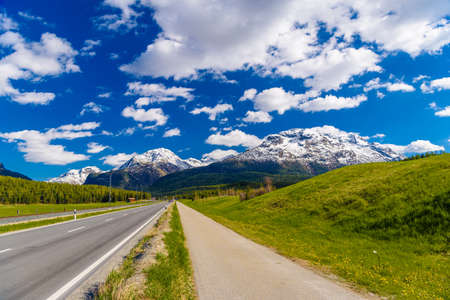 Road with Alps mountains, Samedan, Maloja Graubuenden Switzerland Imagens