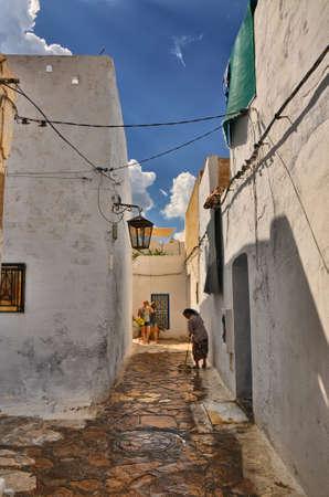 HAMMAMET, TUNISIA - OCT 2014: Narrow street of ancient Medina on October 6, 2014 in Hammamet, Tunisia