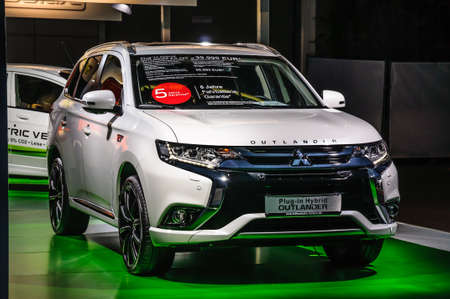 FRANKFURT - SEPT 2015: Mitsubishi Outlander plug-in Hybrid presented at IAA International Motor Show on September 20, 2015 in Frankfurt, Germany Stok Fotoğraf - 128619886
