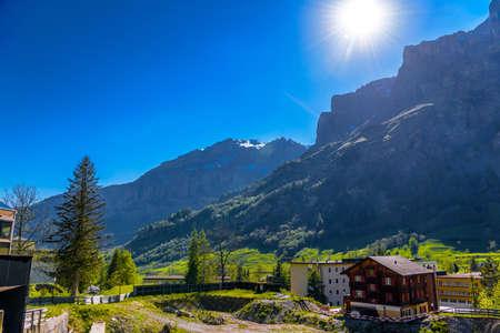 Sun rays in Swiss Village in Alp mountains, Leukerbad, Leuk, Visp, Wallis, Valais Switzerland Standard-Bild - 133544724