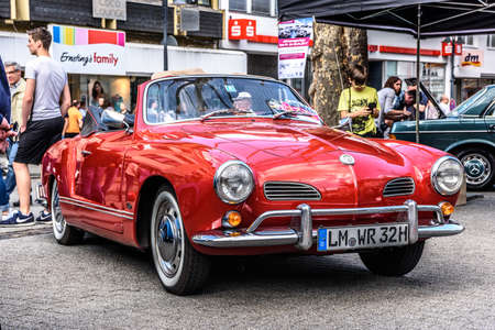 GERMANY, LIMBURG - APR 2017: red VW VOLKSWAGEN KARMANN-GHIA TYP 14 CONVERTIBLE CABRIO 1955 in Limburg an der Lahn, Hesse, Germany.