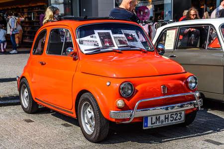 GERMANY, LIMBURG - APR 2017: red orange FIAT 500 L 1967 in Limburg an der Lahn, Hesse, Germany. Editorial