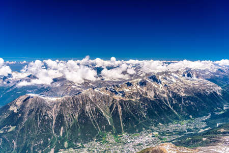 Valley with villages between snowy mountains Chamonix, Mont Blanc, Haute-Savoie, Alps, France.