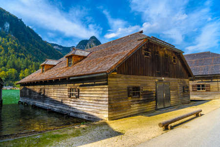 Wooden old houses on the lake in Schoenau am Koenigssee, Konigsee, Berchtesgaden National Park, Bavaria, Germany.