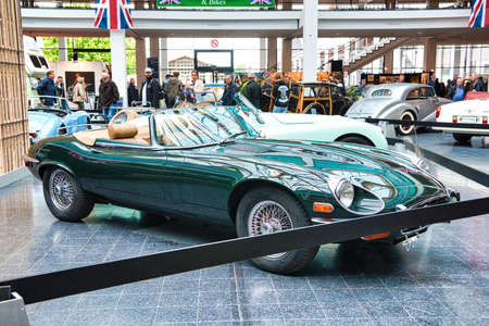 FRIEDRICHSHAFEN - MAY 2019: dark green JAGUAR E-TYPE V12 1974 cabrio roadster at Motorworld Classics Bodensee on May 11, 2019 in Friedrichshafen, Germany.