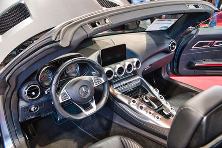 FRIEDRICHSHAFEN - MAY 2019: interior of silver carbon MERCEDES-AMG GT C190 R190 2014 cabrio at Motorworld Classics Bodensee on May 11, 2019 in Friedrichshafen, Germany. Stok Fotoğraf - 128621132