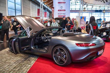 FRIEDRICHSHAFEN - MAY 2019: silver carbon MERCEDES-AMG GT C190 R190 2014 cabrio at Motorworld Classics Bodensee on May 11, 2019 in Friedrichshafen, Germany. Stok Fotoğraf - 128621135