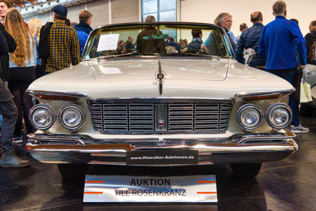 FRIEDRICHSHAFEN - MAY 2019: white CHRYSLER IMPERIAL CROWN 1963 cabrio at Motorworld Classics Bodensee on May 11, 2019 in Friedrichshafen, Germany.