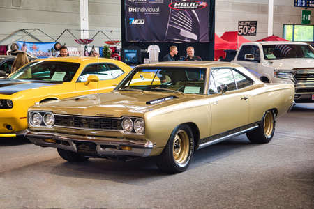 FRIEDRICHSHAFEN - MAY 2019: golden sand PLYMOUTH ROAD RUNNER 1968 at Motorworld Classics Bodensee on May 11, 2019 in Friedrichshafen, Germany.