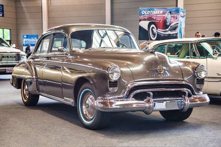 FRIEDRICHSHAFEN - MAY 2019: sand brown OLDSMOBILE 1949 at Motorworld Classics Bodensee on May 11, 2019 in Friedrichshafen, Germany.