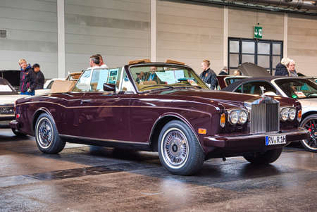 FRIEDRICHSHAFEN - MAY 2019: maroon ROLLS-ROYCE CORNICHE 2 II 1986 cabrio at Motorworld Classics Bodensee on May 11, 2019 in Friedrichshafen, Germany.