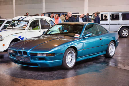 FRIEDRICHSHAFEN - MAY 2019: blue BMW 8 840 E31 Ci 1990 coupe at Motorworld Classics Bodensee on May 11, 2019 in Friedrichshafen, Germany.