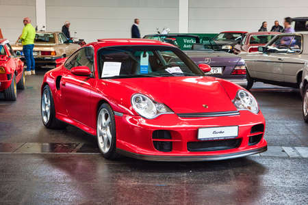 FRIEDRICHSHAFEN - MAY 2019: red PORSCHE 911 996 TURBO coupe 2000 at Motorworld Classics Bodensee on May 11, 2019 in Friedrichshafen, Germany. Stok Fotoğraf - 128621275