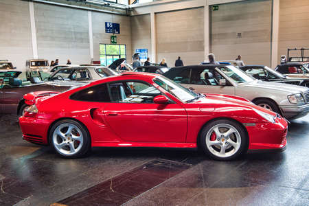 FRIEDRICHSHAFEN - MAY 2019: red PORSCHE 911 996 TURBO coupe 2000 at Motorworld Classics Bodensee on May 11, 2019 in Friedrichshafen, Germany. Stok Fotoğraf - 128621276