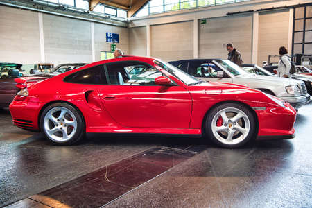 FRIEDRICHSHAFEN - MAY 2019: red PORSCHE 911 996 TURBO coupe 2000 at Motorworld Classics Bodensee on May 11, 2019 in Friedrichshafen, Germany. Stok Fotoğraf - 128621281