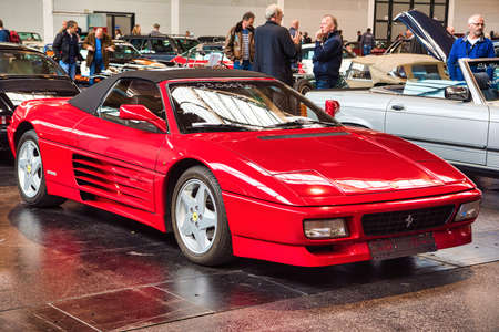 FRIEDRICHSHAFEN - MAY 2019: red FERRARI 348 SPIDER 1994 cabrio at Motorworld Classics Bodensee on May 11, 2019 in Friedrichshafen, Germany. Stok Fotoğraf - 128621282