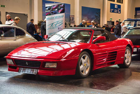FRIEDRICHSHAFEN - MAY 2019: red FERRARI 348 SPIDER 1994 cabrio at Motorworld Classics Bodensee on May 11, 2019 in Friedrichshafen, Germany. Stok Fotoğraf - 128621288