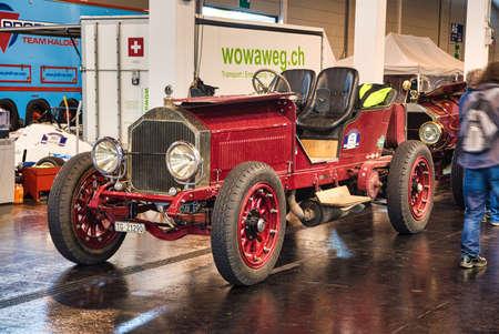 FRIEDRICHSHAFEN - MAY 2019: red LANCIA GAMMA 20 HP TIPO 55 1910 cabrio at Motorworld Classics Bodensee on May 11, 2019 in Friedrichshafen, Germany.