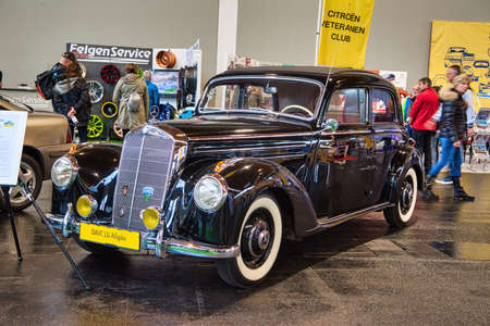 FRIEDRICHSHAFEN - MAY 2019: black MERCEDES-BENZ 220 W187 1953 coupe at Motorworld Classics Bodensee on May 11, 2019 in Friedrichshafen, Germany. Stok Fotoğraf - 128621306