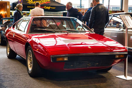 FRIEDRICHSHAFEN - MAY 2019: red FERRARI DINO 208 GT4 1977 coupe at Motorworld Classics Bodensee on May 11, 2019 in Friedrichshafen, Germany.