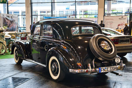 FRIEDRICHSHAFEN - MAY 2019: black MERCEDES-BENZ 220 W187 1953 coupe at Motorworld Classics Bodensee on May 11, 2019 in Friedrichshafen, Germany.