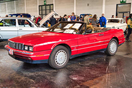 FRIEDRICHSHAFEN - MAY 2019: red CADILLAC ALLANTE 1989 cabrio at Motorworld Classics Bodensee on May 11, 2019 in Friedrichshafen, Germany.