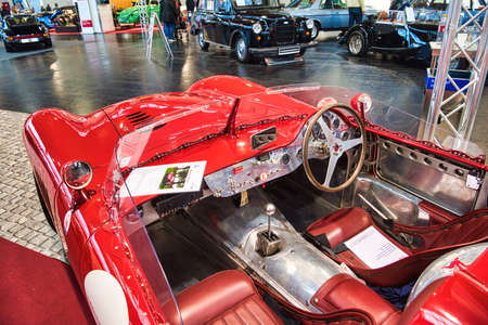 FRIEDRICHSHAFEN - MAY 2019: interior of red MASERATI MISTRAL 300S TRIBUTE R 1966 cabrio roadster at Motorworld Classics Bodensee on May 11, 2019 in Friedrichshafen, Germany.