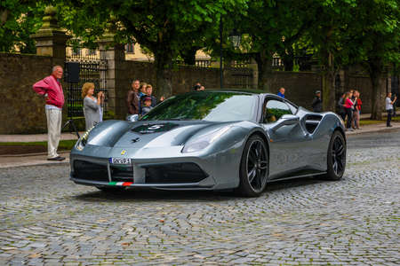 GERMANY, FULDA - JUL 2019: gray silver FERRARI 488 coupe Type F142M is a mid-engine sports car produced by the Italian automobile manufacturer Ferrari. The car is an update to the 458 with notable exterior and performance changes. The car is powered by a Redakční