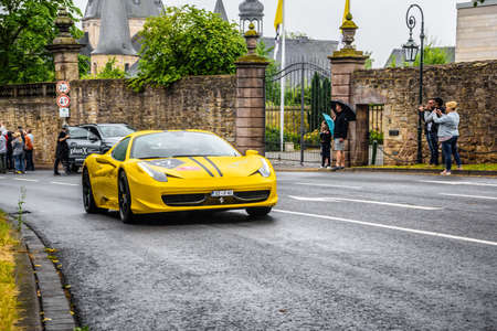 GERMANY, FULDA - JUL 2019: yellow FERRARI 458 SPIDER coupe was introduced at the 2011 Frankfurt Motor Show. This convertible variant of the 458 Italia features an aluminium retractable hardtop which, according to Ferrari, weighs 25 kilograms less than a s