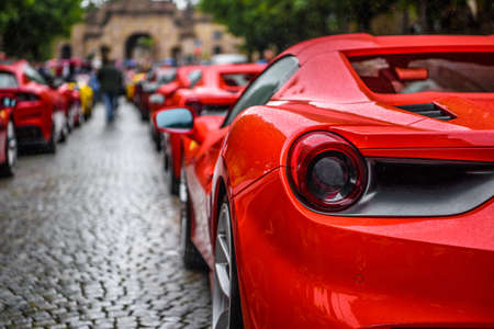 GERMANY, FULDA - JUL 2019: rearview lights of red FERRARI 488 SPIDER Type F142M coupe is a mid-engine sports car produced by the Italian automobile manufacturer Ferrari. The car is an update to the 458 with notable exterior and performance changes. The ca