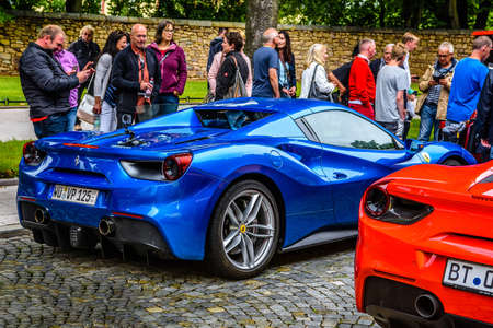 GERMANY, FULDA - JUL 2019: rearview lights of blue FERRARI 488 SPIDER Type F142M coupe is a mid-engine sports car produced by the Italian automobile manufacturer Ferrari. The car is an update to the 458 with notable exterior and performance changes. The c Editorial