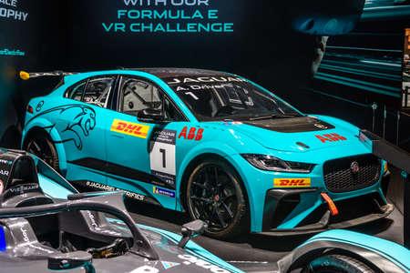 FRANKFURT, GERMANY - SEPT 2019: blue azure JAGUAR I-PACE DHL electric sport racing SUV, IAA International Motor Show Auto Exhibtion.