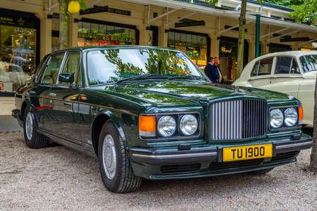 BADEN BADEN, GERMANY - JULY 2019: dark green Crewe Vickers BENTLEY TURBO R 1985, oldtimer meeting in Kurpark.