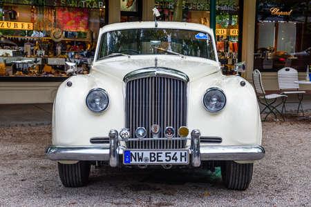 BADEN BADEN, GERMANY - JULY 2019: white Crewe Rolls-Royce BENTLEY CONTINENTAL S S1 1955, oldtimer meeting in Kurpark.