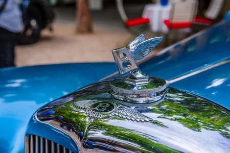 BADEN BADEN, GERMANY - JULY 2019: logo of blue Crewe Rolls-Royce BENTLEY R TYPE cabrio 1953, oldtimer meeting in Kurpark.
