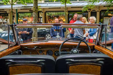 BADEN BADEN, GERMANY - JULY 2019: wooden interior of Crewe Rolls-Royce BENTLEY R TYPE cabrio 1953, oldtimer meeting in Kurpark.