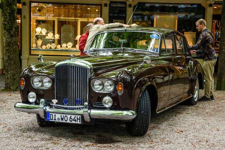 BADEN BADEN, GERMANY - JULY 2019: dark brown Crewe Rolls-Royce BENTLEY CONTINENTAL S S3 coupe oldtimer meeting in Kurpark.